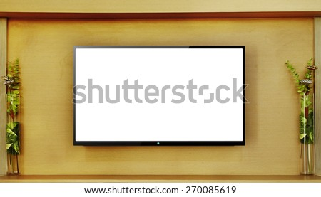 Led tv hanging on wood wall background - stock photo