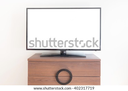 Led TV on TV stand on table. Clipping path included. - stock photo
