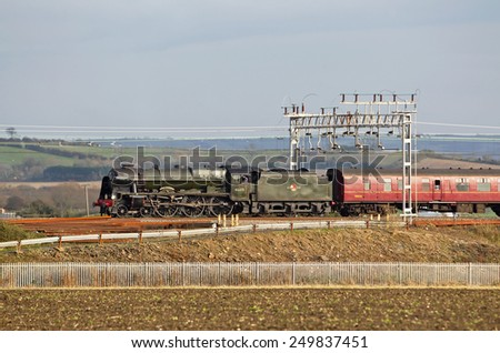 LEDBURN, UK - November 10: Ex LMS steam loco Scots Guardsman heads back to Carnforth with empty stock having completed the Robin Hood trip over the previous weekend on November 10, 2014 in Ledburn - stock photo