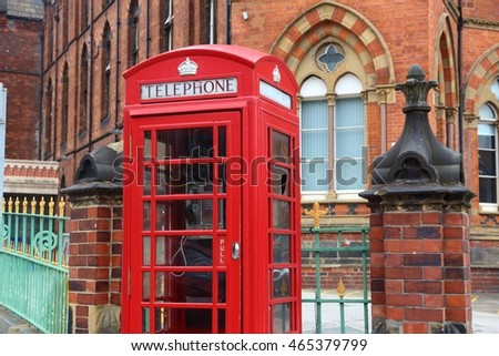 Leeds - city in West Yorkshire, UK. Red telephone and Leeds General Infirmary in background.