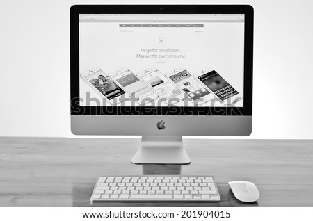 LEEDS - JULY 01: APPLE iMac with new iOS 8 software launch details on screen. July 01, 2014 in Leeds, UK. - stock photo