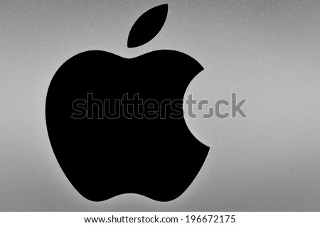 LEEDS - JUNE 4: Black Apple logo on brushed aluminium background. June 4, 2014 in Leeds, UK. - stock photo
