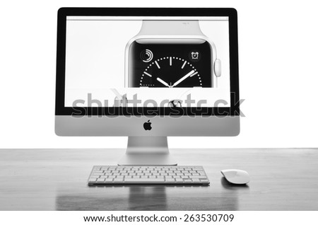 LEEDS - MARCH 25: Apple iMac with the new iWatch displayed on the screen, image processed in black and white. March 25, 2015 in Leeds Yorkshire, UK.