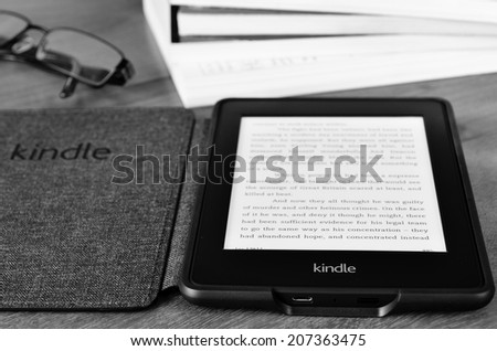 LEEDS, UK - JULY 16: Amazon Kindle paper white e book reader, processed in black and white. July 16, 2014 in Leeds, UK. - stock photo