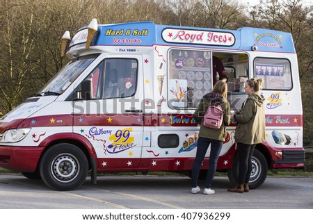 LEEDS, UK - 25 MARCH 2016.  Girls buying an ice cream from an Ice Cream van. - stock photo
