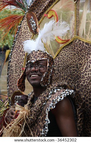 LEEDS, YORKSHIRE, UK: An unidentified parade participant, dressed as a Witch Doctor, smiles during the Leeds West Indian Carnival on August 31, 2009 in Leeds, UK.