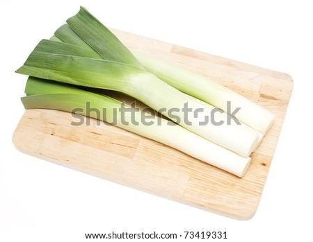 leek on wooden board - stock photo
