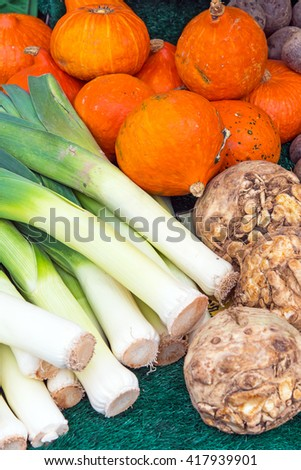 Leek, pumpkin and celery for sale at a market