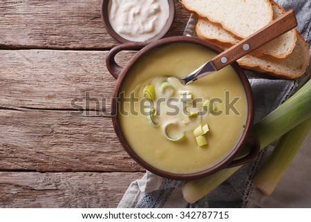 leek puree soup with sour cream on the table. horizontal view from above - stock photo