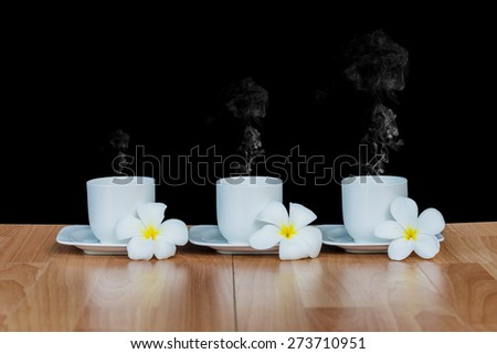 Leelavadee (Plumeria) tropical flower have white cup coffee with smoke  - stock photo