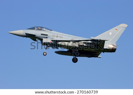 LEEUWARDEN, NETHERLANDS - APRIL 15, 2015: German Air Force Eurofighter landing during the exercise Frisian Flag. The exercise is considered one of the most important NATO training events this year. - stock photo