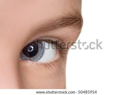 left blue eye of child close up isolated on white background - stock photo
