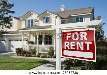 Left Facing Red For Rent Real Estate Sign in Front of Beautiful House. - stock photo