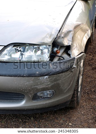 Left front part of car damaged in road accident       - stock photo