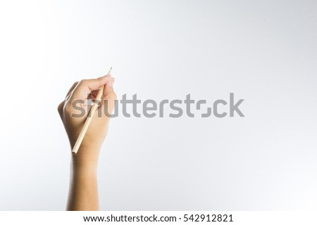 Left hand holding a pencil isolated on white background