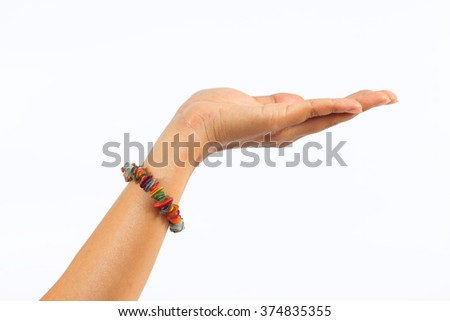 left hand woman showing for grabs and bracelet on white background - stock photo