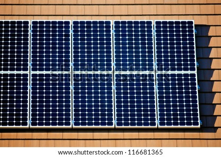 Left side of solar panels on the roof of a new home - stock photo