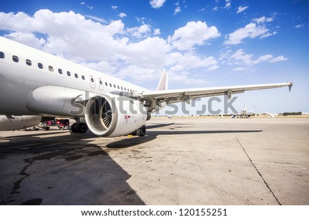 left wing of a commercial airplane - stock photo