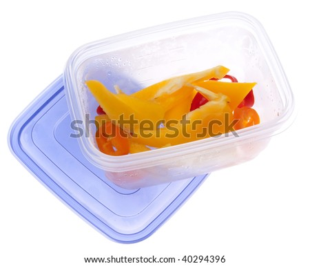 Leftover Cut Peppers in a plastic container with condensation from refrigeration.