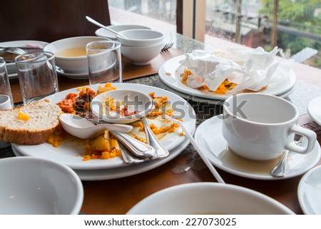 Leftover food on the table. - stock photo