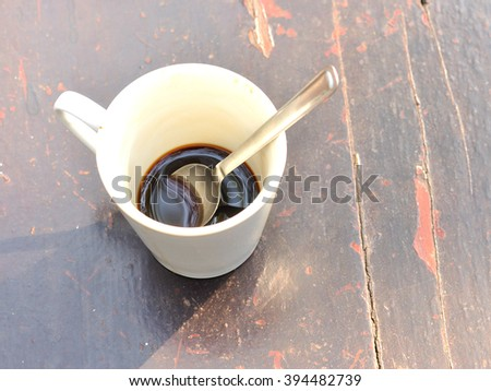 Leftover hot coffee on wooden background, Black coffee - stock photo