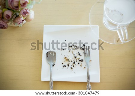 leftover of milk with glass on wood table - stock photo