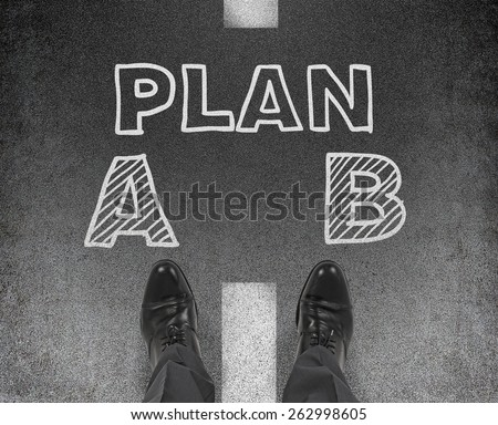 leg businessman standing on drawing plan A and B, choice concept - stock photo