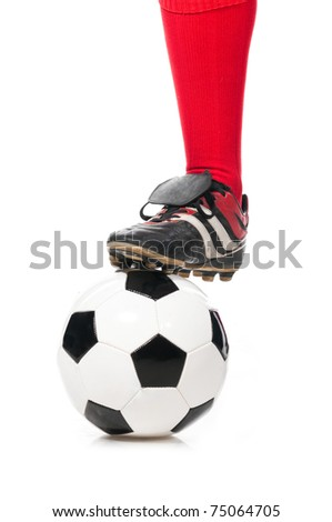 leg of soccer player with ball isolated on white - stock photo