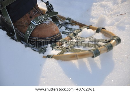 Leg with typical snowshoes - stock photo