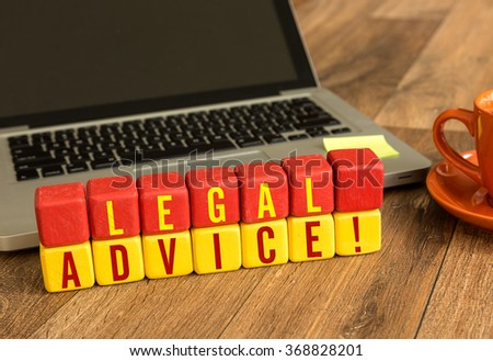 Legal Advice written on a wooden cube in a office desk - stock photo