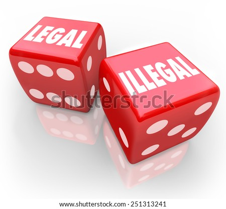 Legal and Illegal words on two red dice to illustrate taking your chances on law and regulation issues - stock photo