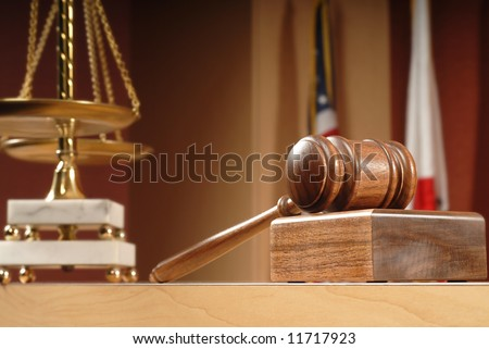 Legal concept still life in a courtroom with American and Californian flags in the background