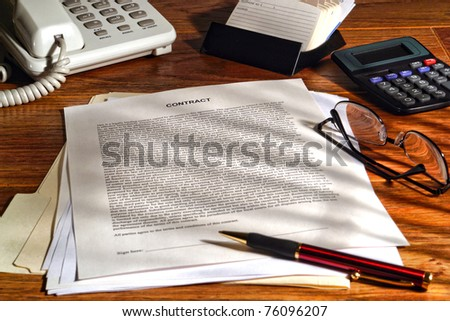 Legal contract in common law English ready to sign with an ink pen on a lawyer desk in a law firm office (fictitious document with authentic legal language) - stock photo