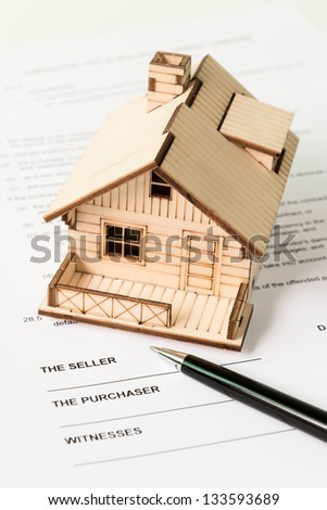 Legal document for sale of real estate property - stock photo