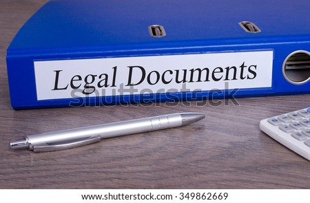 Legal Documents - blue binder on desk in the office with pen and calculator - stock photo