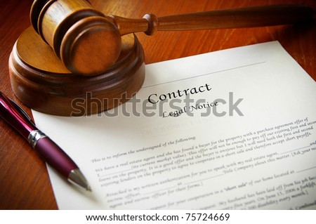 legal gavel and a business contract