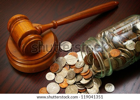 legal gavel and coins in a coin jar - stock photo