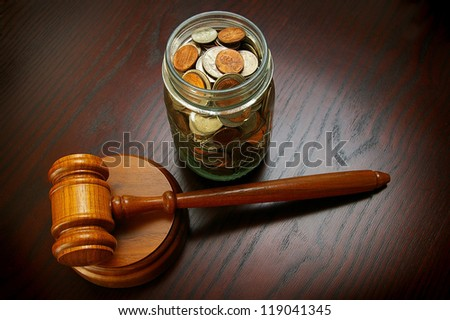 legal gavel with coins in a jar - stock photo
