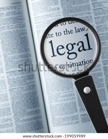 """legal /Magnifying glass on the""""legal"""" in dictionary - stock photo"""