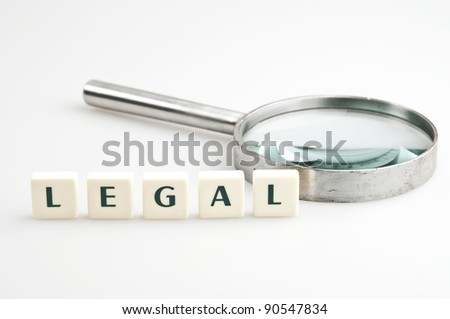Legal word and magnifying glass - stock photo
