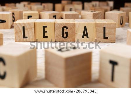 LEGAL word written on wood block - stock photo
