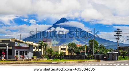 "Legaspi City, Philippines - May 13, 2011: Mayon Volcano, renowned as the ""perfect cone"" because of its almost symmetric conical shape. View from Legaspi City, Albay, Philippines. - stock photo"