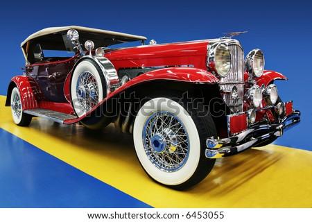 Legendary Duesenberg Automobile - Red on dramatic background - stock photo