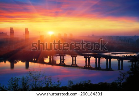Legendary metal bridge Paton at dawn, amid new quarters, symbolizes the new and the old town - stock photo