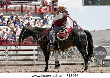 Legendary Rodeo Stock Contractor and ProRodeo Hall of Fame member, Harry Vold, supervises the 2005 Cheyenne Frontier Days rodeo from horseback. - stock photo