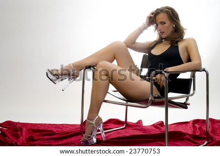Leggy Model Draped Across a Modernist Chair. - stock photo
