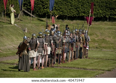 legion of roman soldiers awaiting orders - stock photo