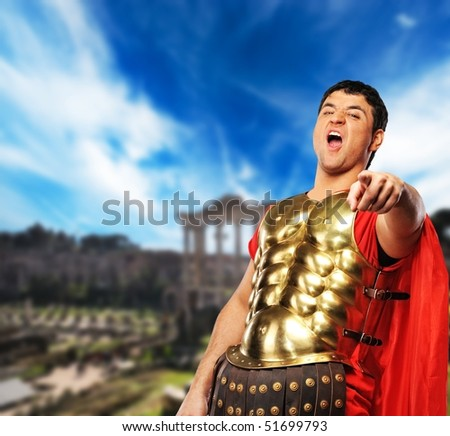 Legionary soldier in front of old city - stock photo