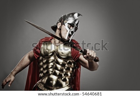 Legionary soldier ready for a fight - stock photo