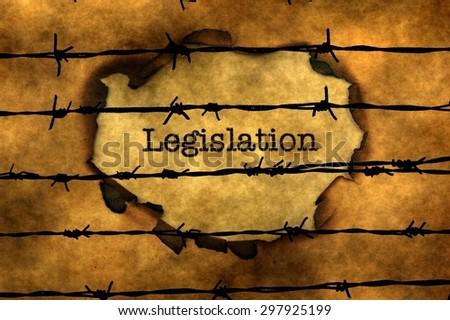 Legislation concept against barbwire - stock photo